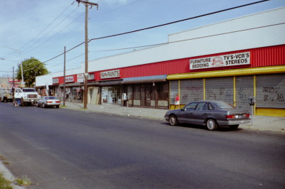 Strip mall old rollup solid gates before demolition (Queens NY) Before photo