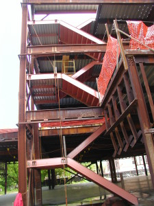 Double structural steel cement pan institutional staircase with steel framed landing, welded galvanized decking, and hanger rods. (Bronx, NY)