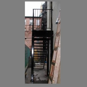Open tread simple steel staircase and guard rail/primed and painted. (Staten Island, NY)