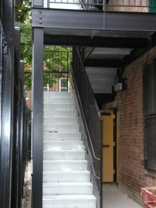 Diamond plate galvanized staircase with guardrail and double handrail. (Bronx, NY)